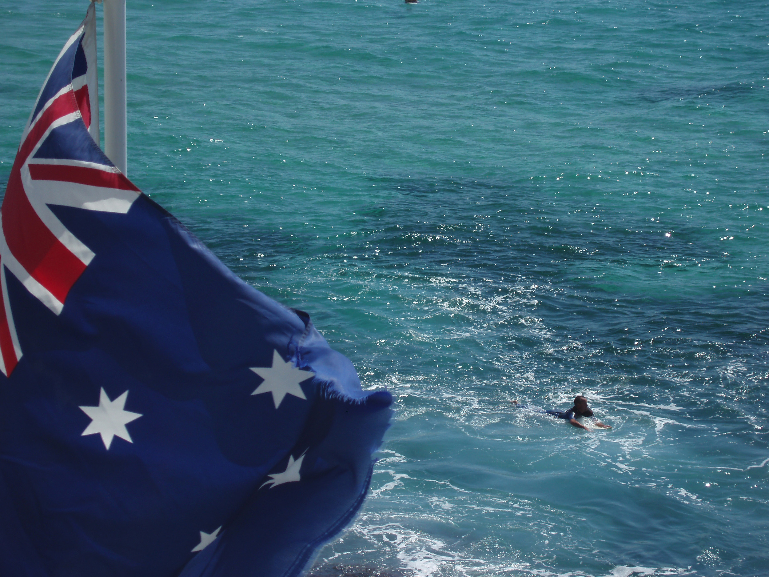 the australian flag and blue cyan waters off the new south wales coast