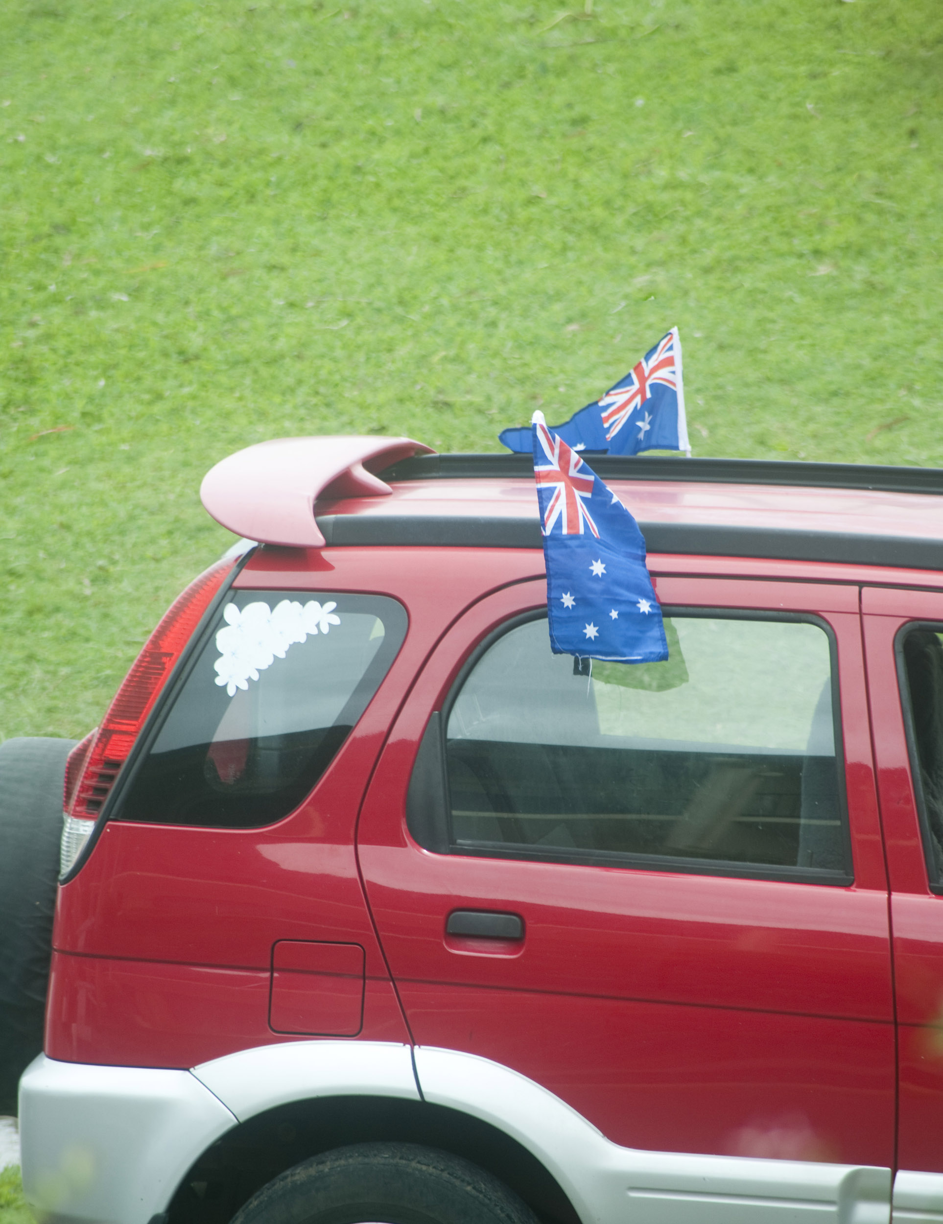 a car decorated with flags for australia day