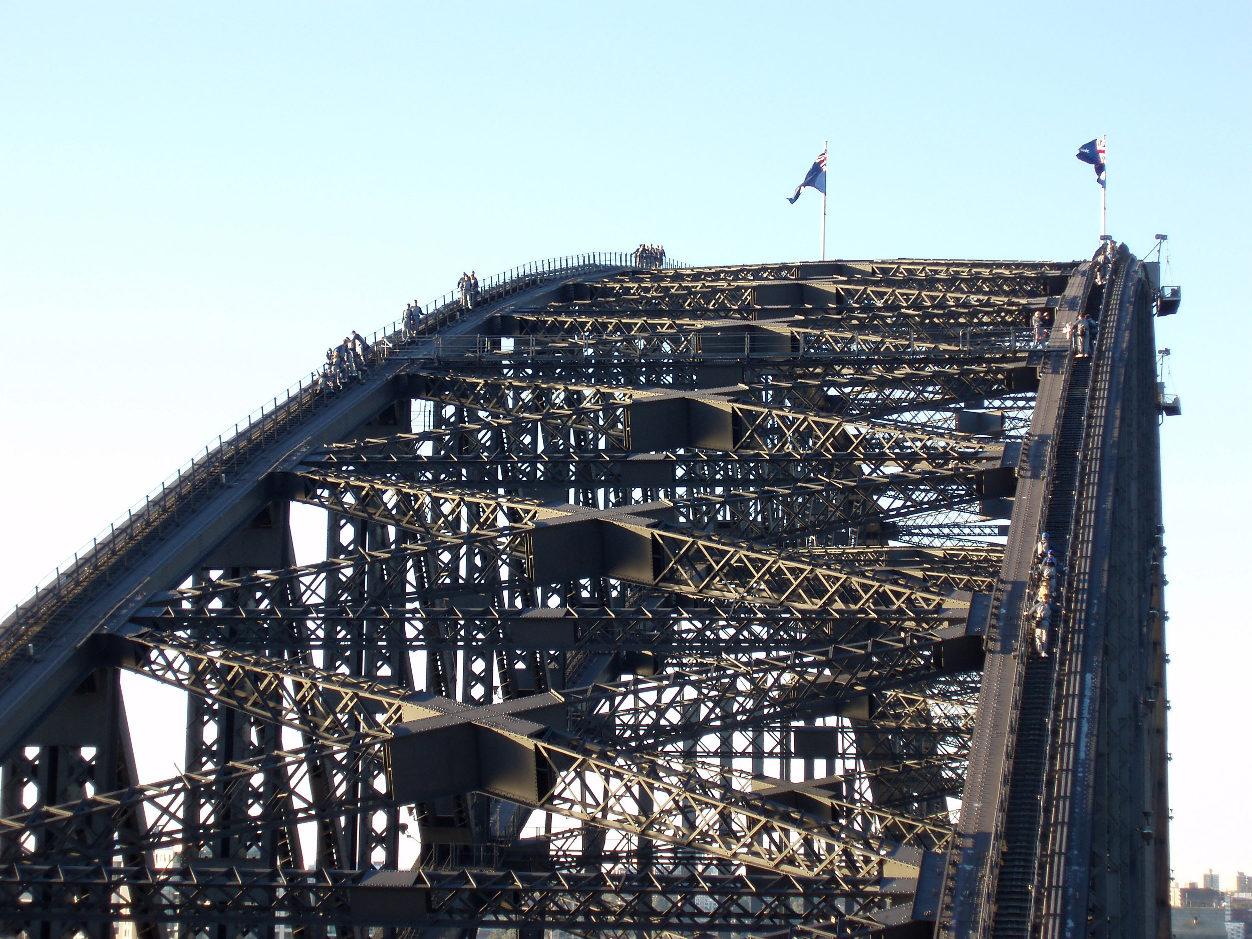 visitors waking across the top of the sydney harbour bridge