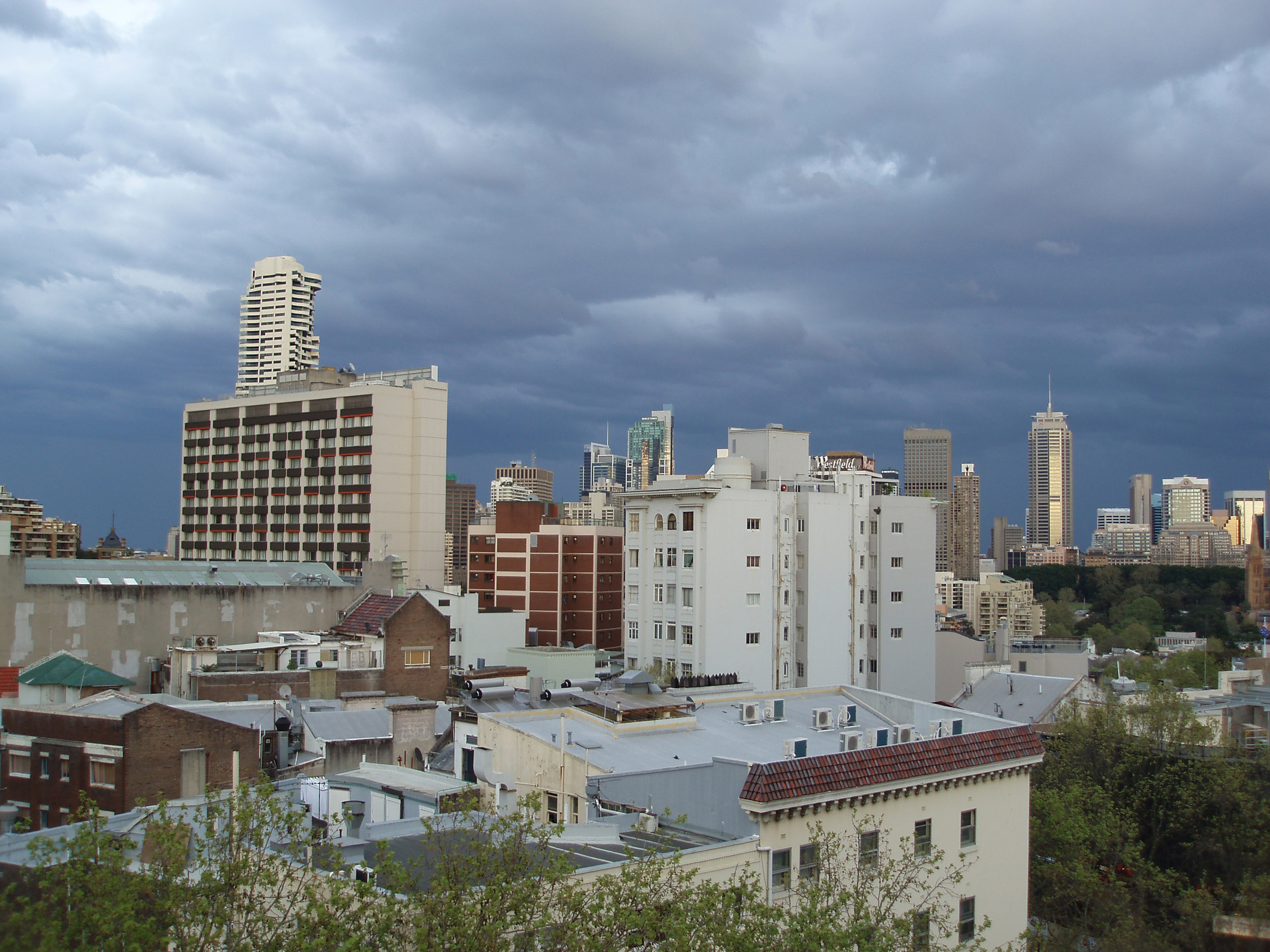 buildings of the sydney city skyline on a stormy day