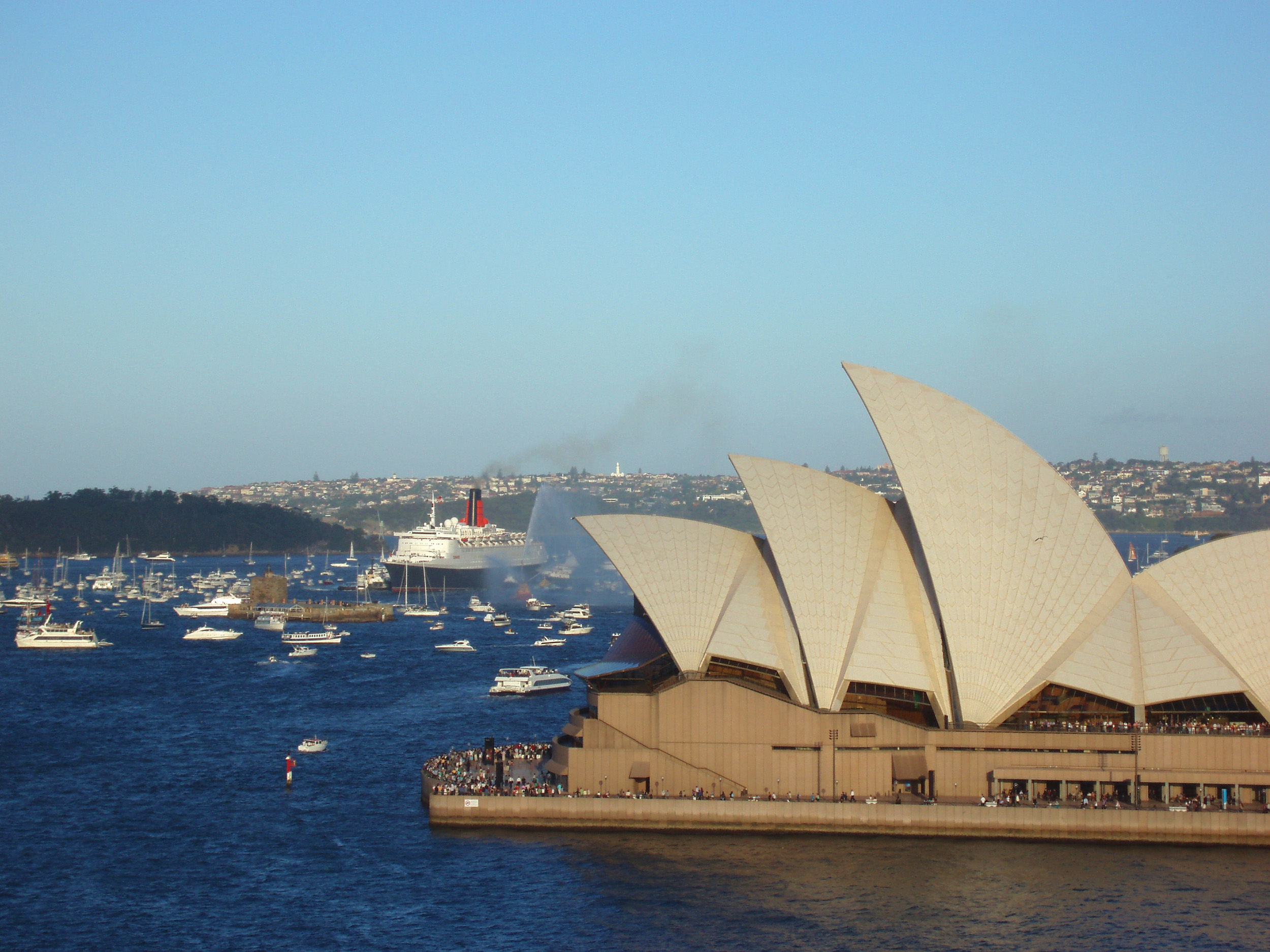iconic sydney landmark and symbol of australia with the QEII arriving in sydney harbour to the rear