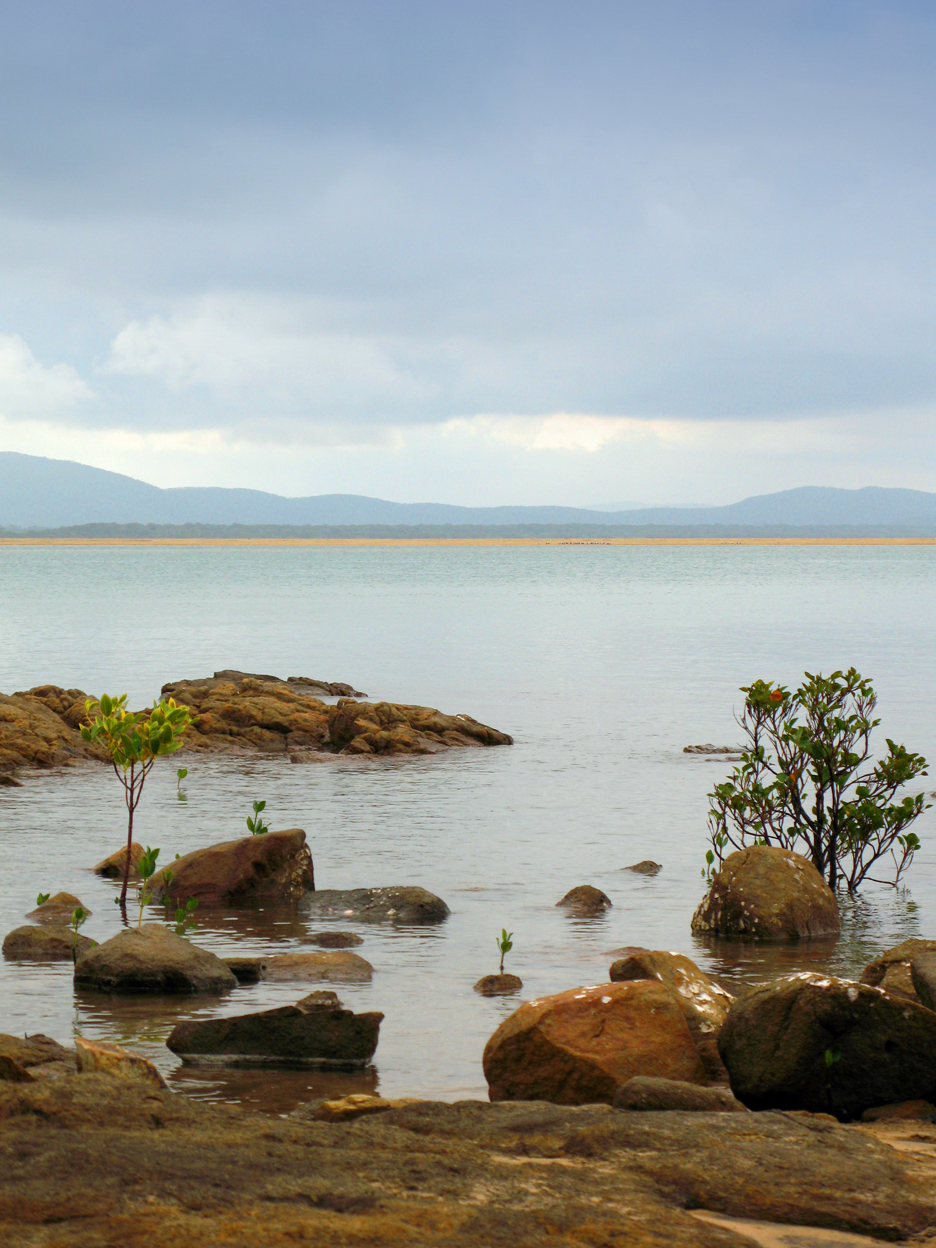 rocks and calm waters on the waterfront at town of 1770, queensland