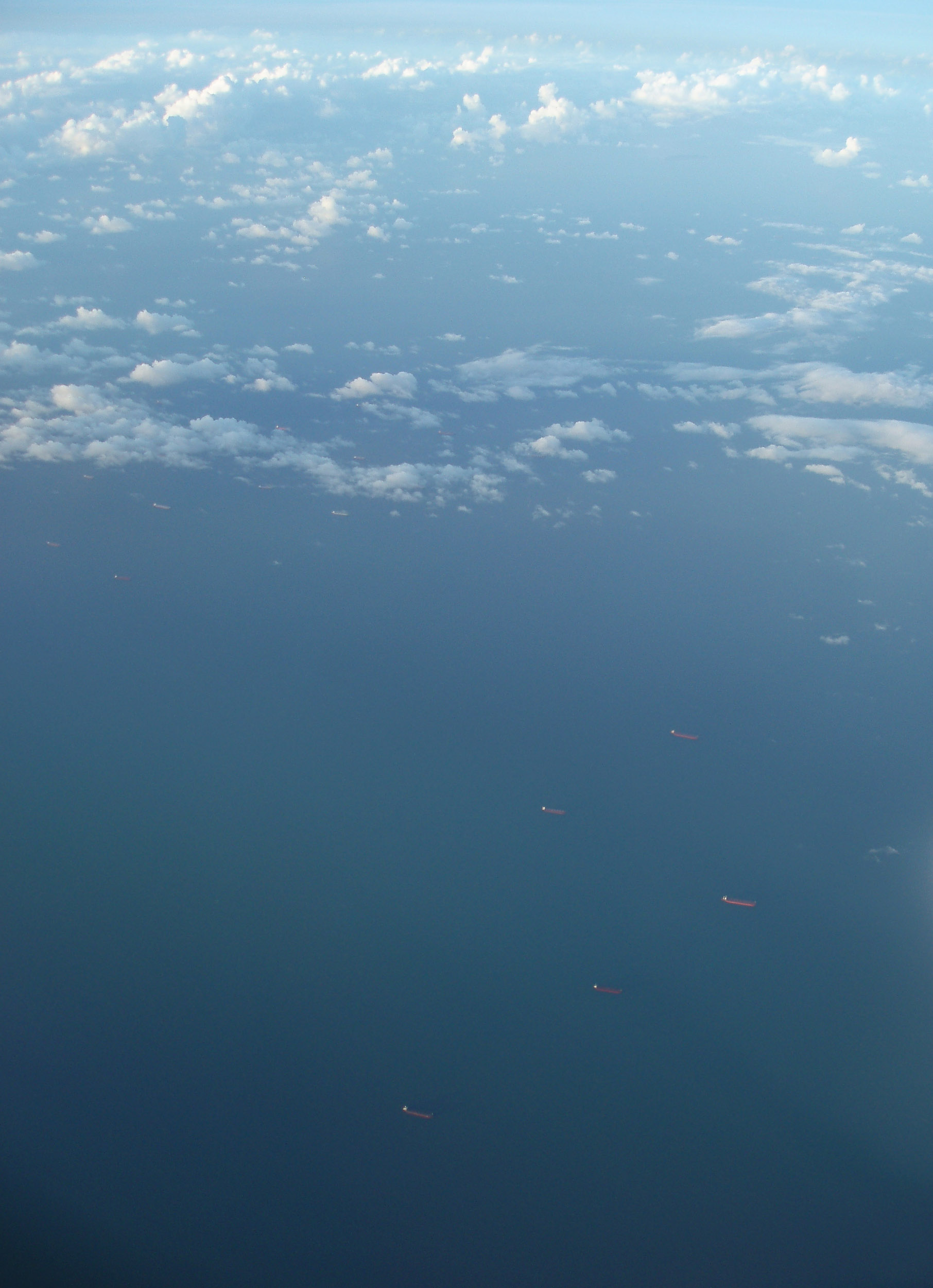 a background image, lines of bulk carrier ships off the queensland coast, gladstone