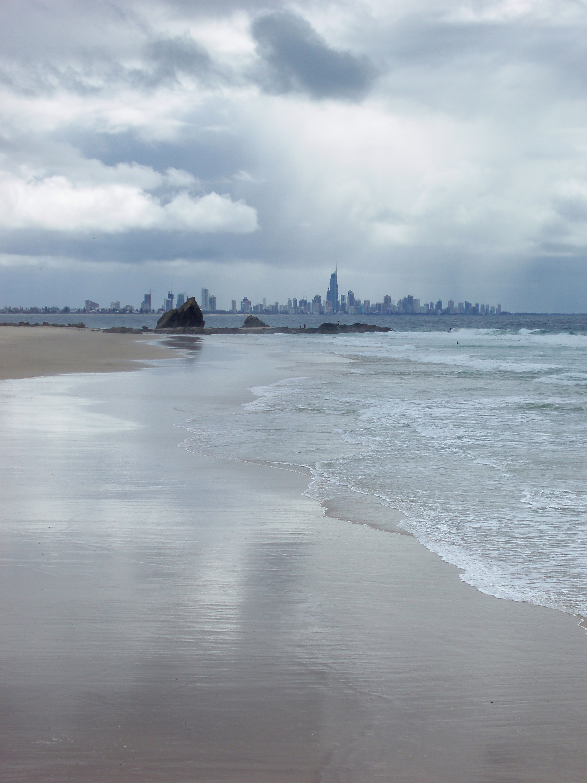 a wet day at currumbin beach, Q1 and the highrises of surfers paradise can be seen in the background
