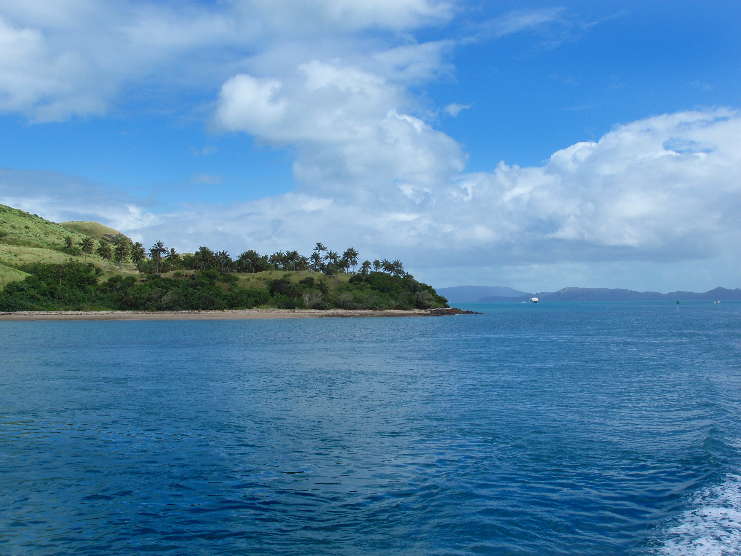 the side of dent island seen from the channel between hamilton island and dent island