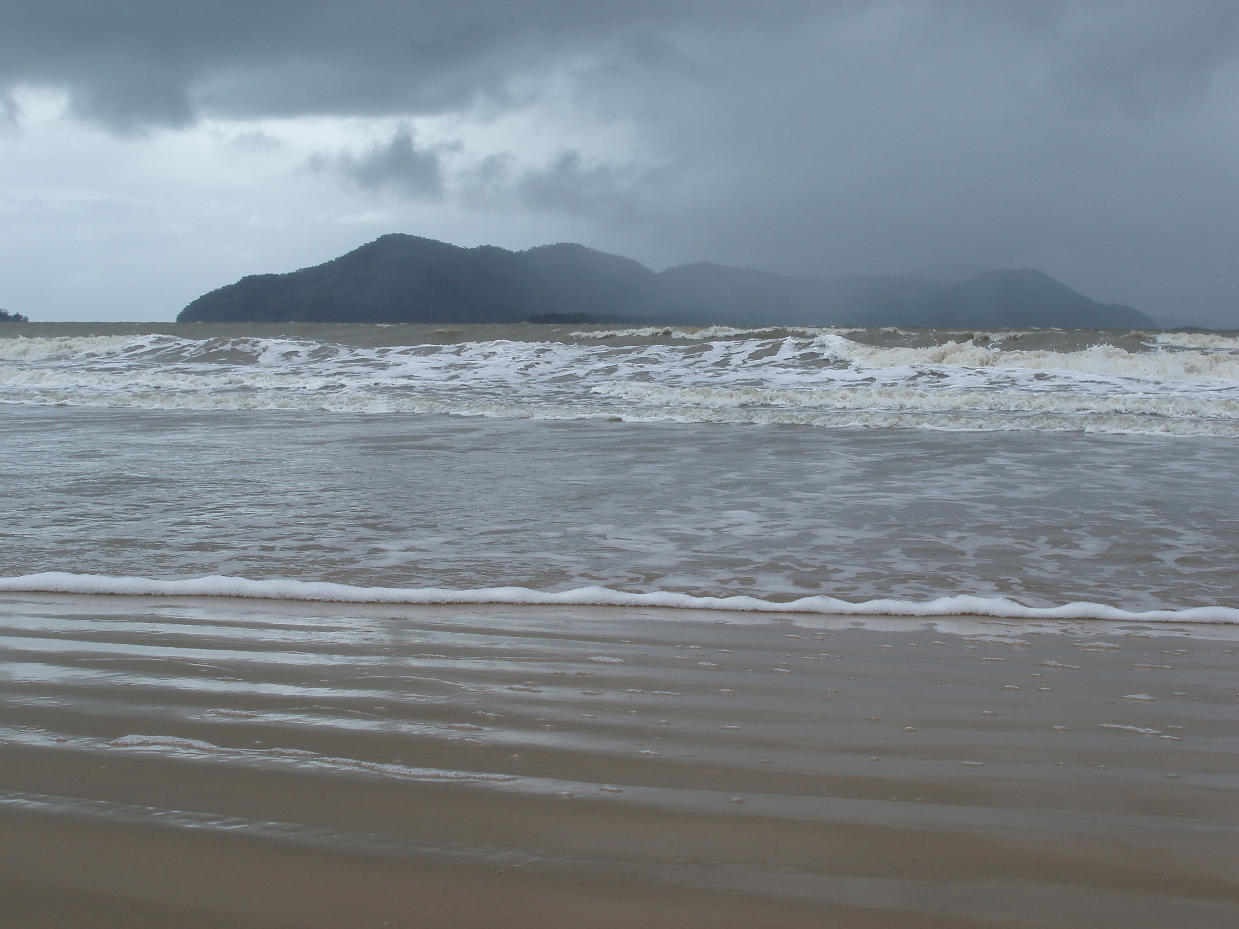 dunk island viewed from south mission beach on a stormy day