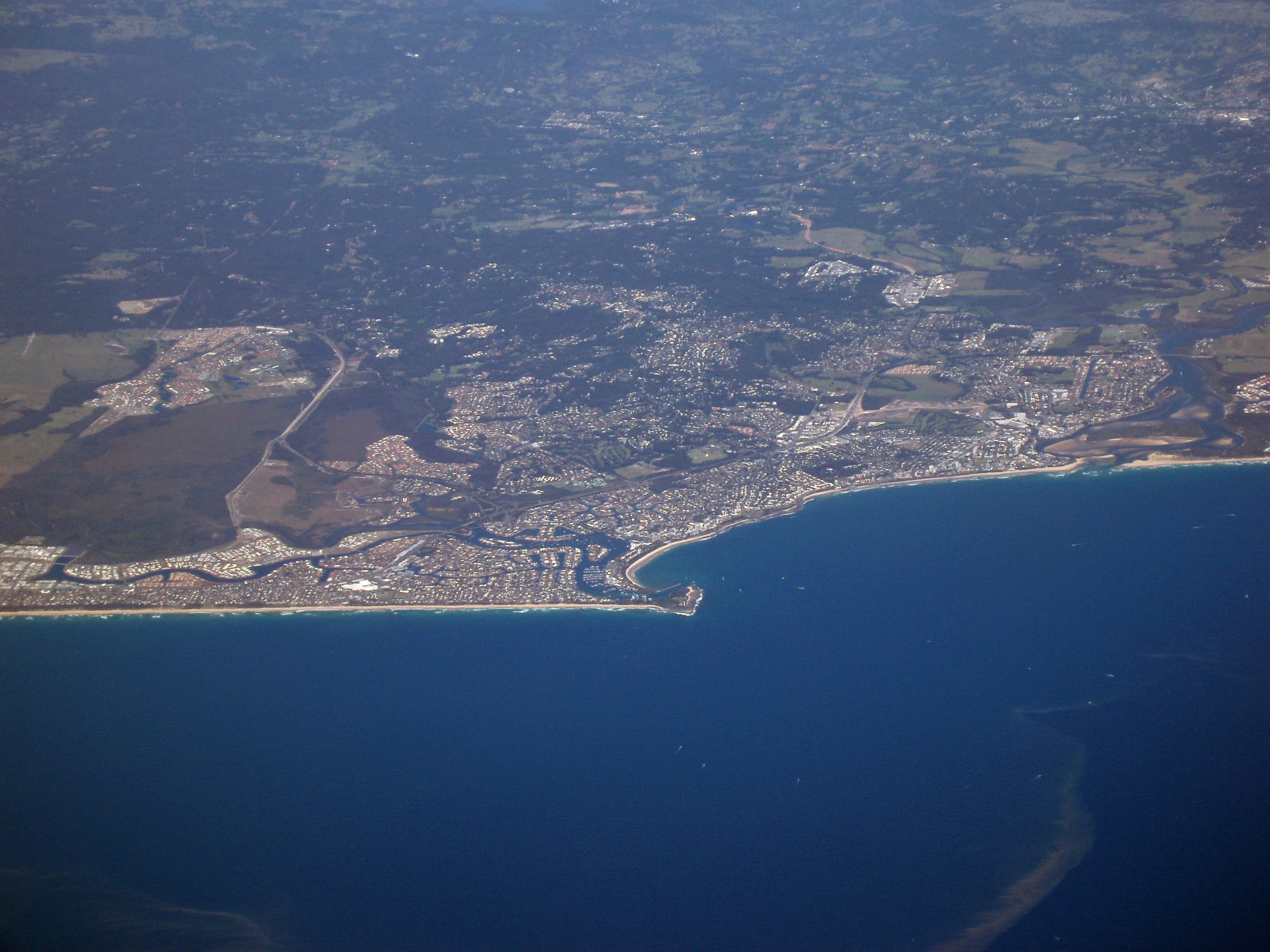an aerial view of the sunshine coast town of mooloolaba