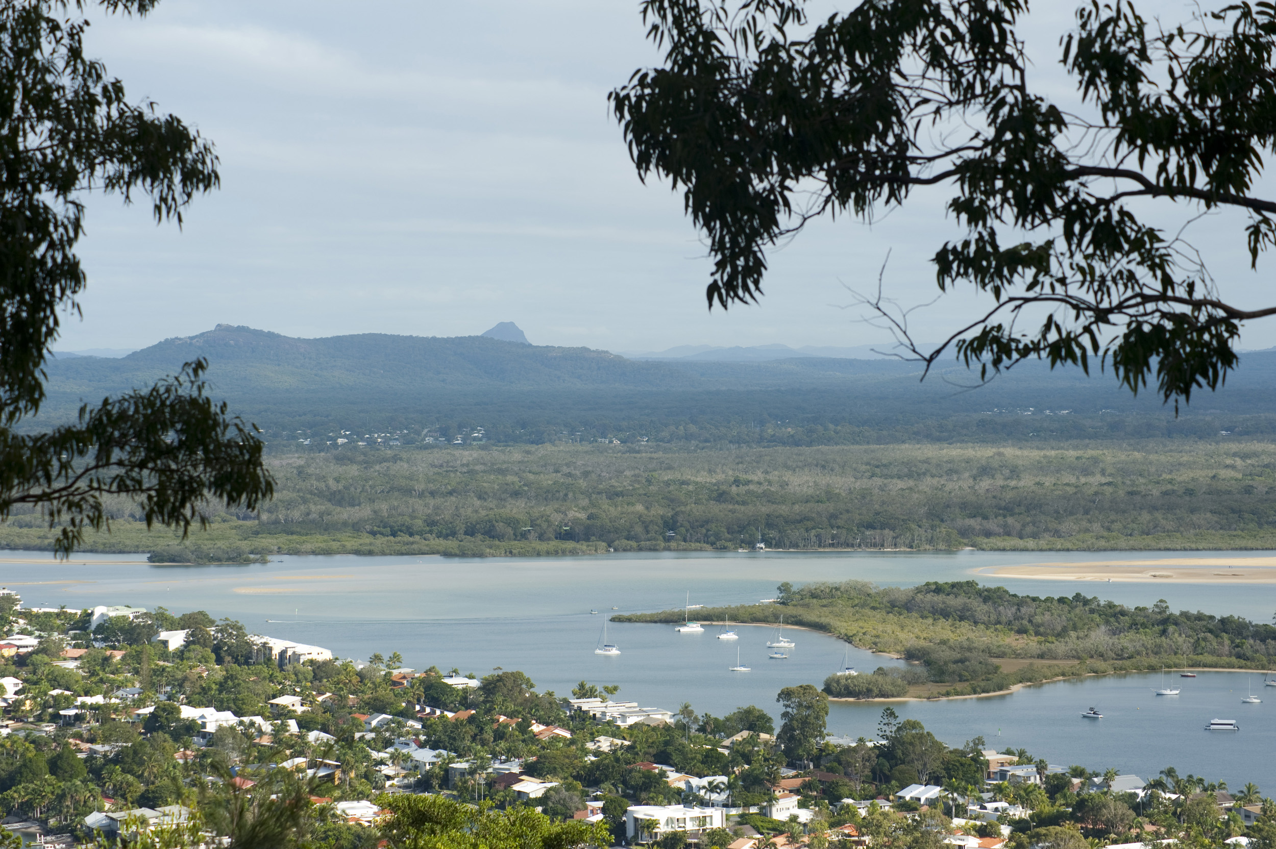 Landscape view of the Noosa hinterland looking across part of the town and the Noosa River estuary to a distant mountain range
