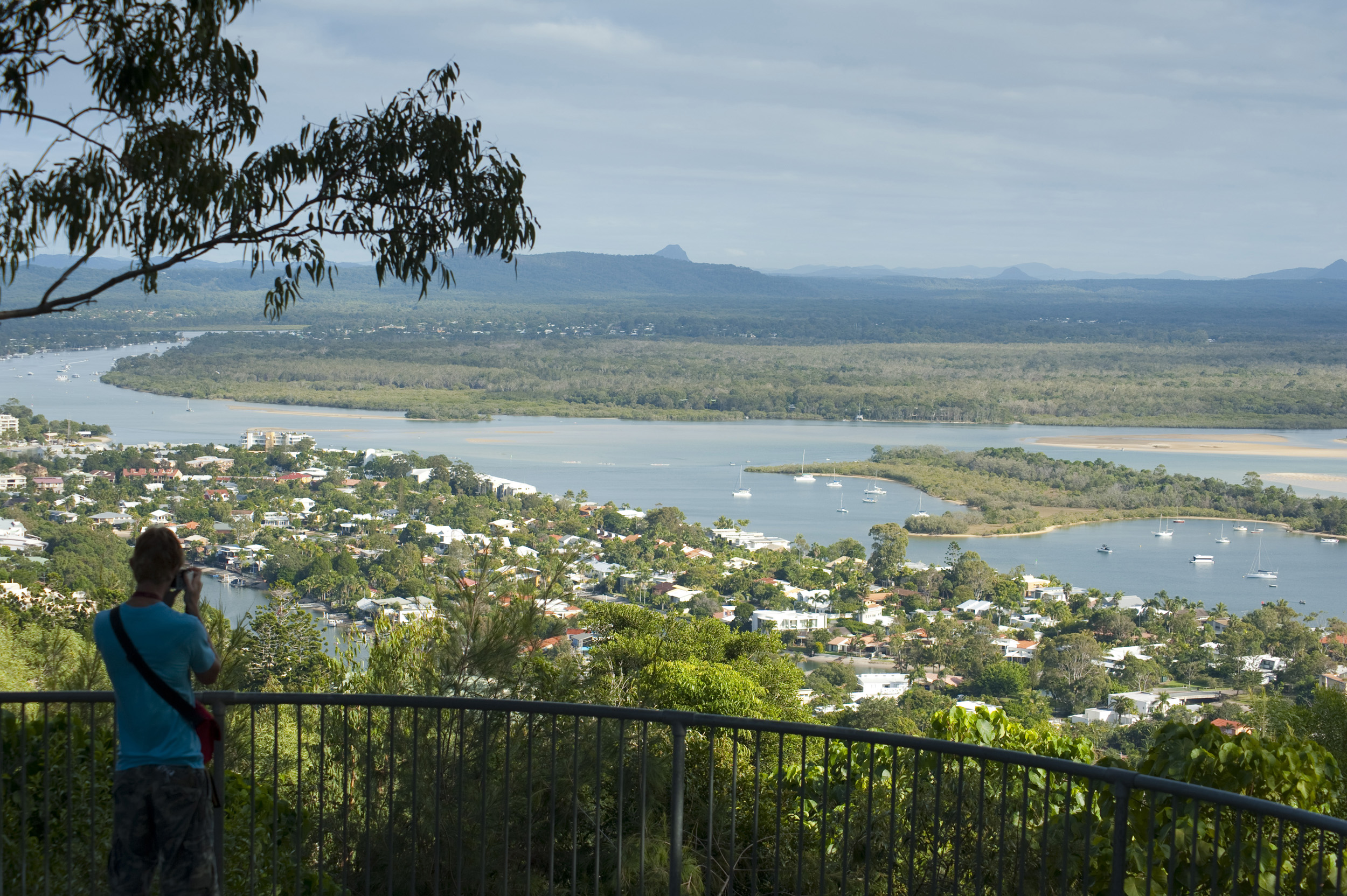 Noosa panorama in Queensland, Australia showing the Noosa estuary with the town nestling in lush tropical vegetation on its banks and a view over the surrounding countryside to distant mountains