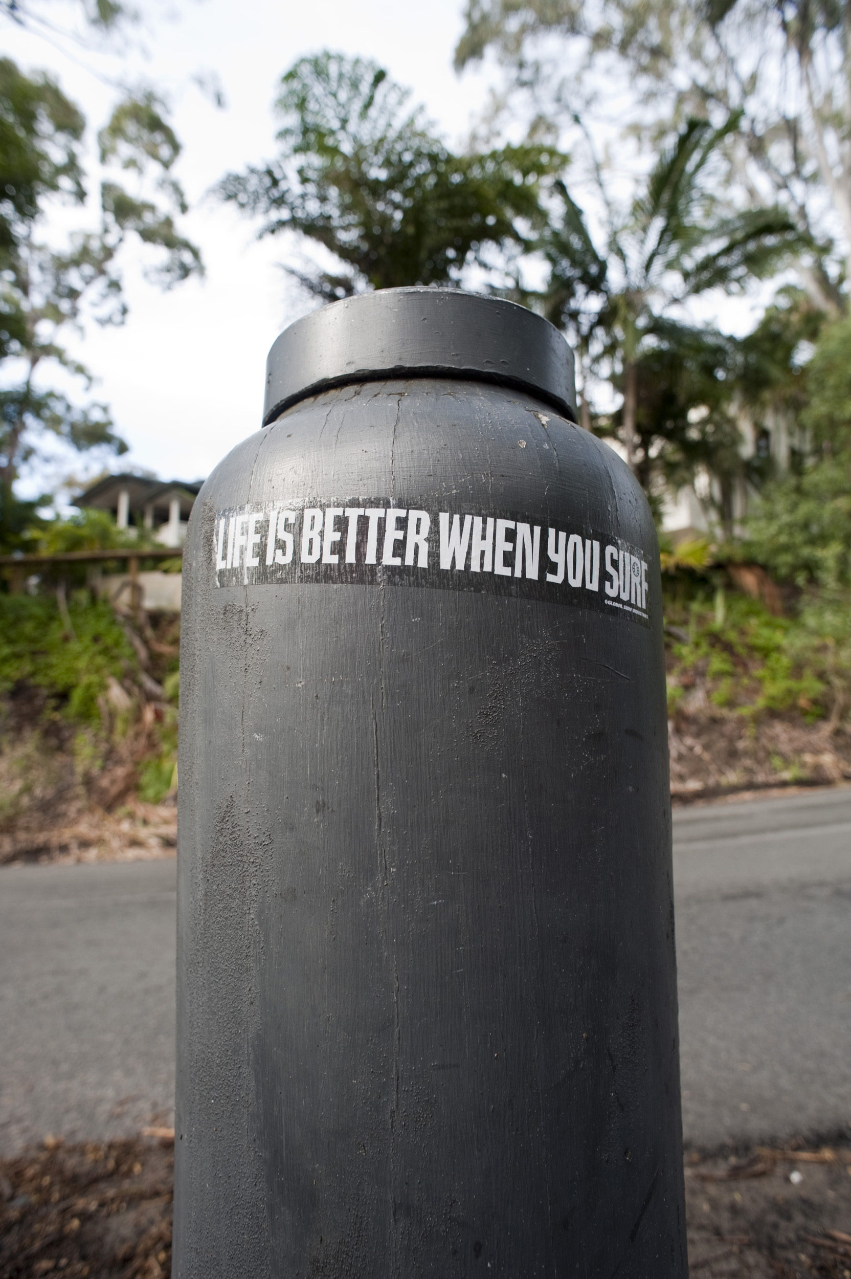 a sticker near a surf beach at noosa with lifes better when your surf written on it