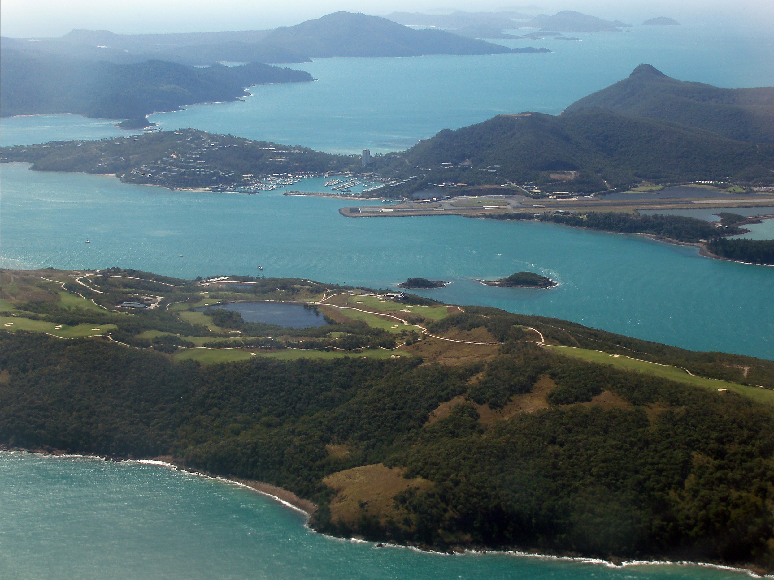 viewed from the air, dent island, hamilton island and whitsunday island to the rear in the whitsunday island group, queensland