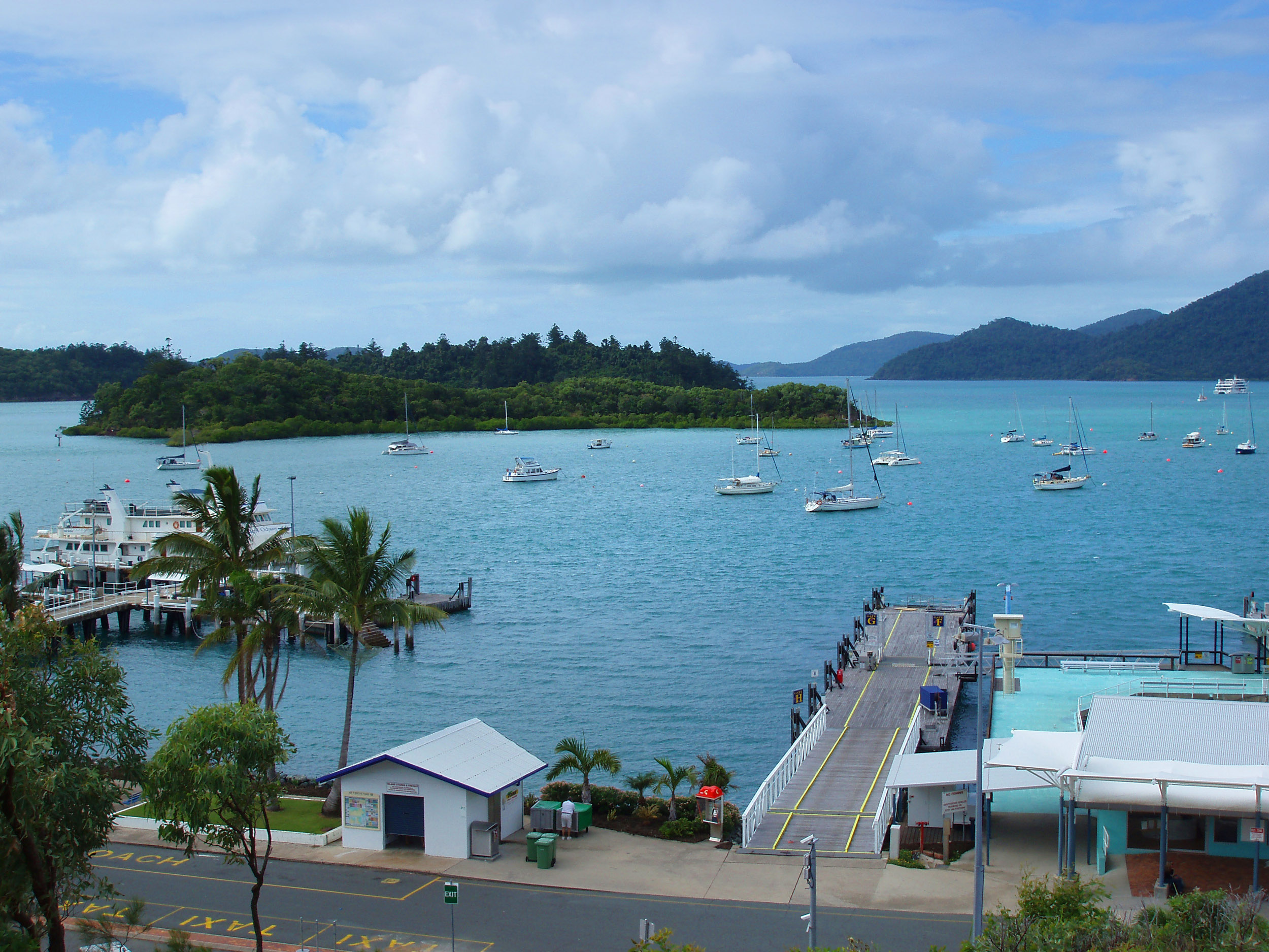 moored yachts on the quayside at shute harbour, queensland
