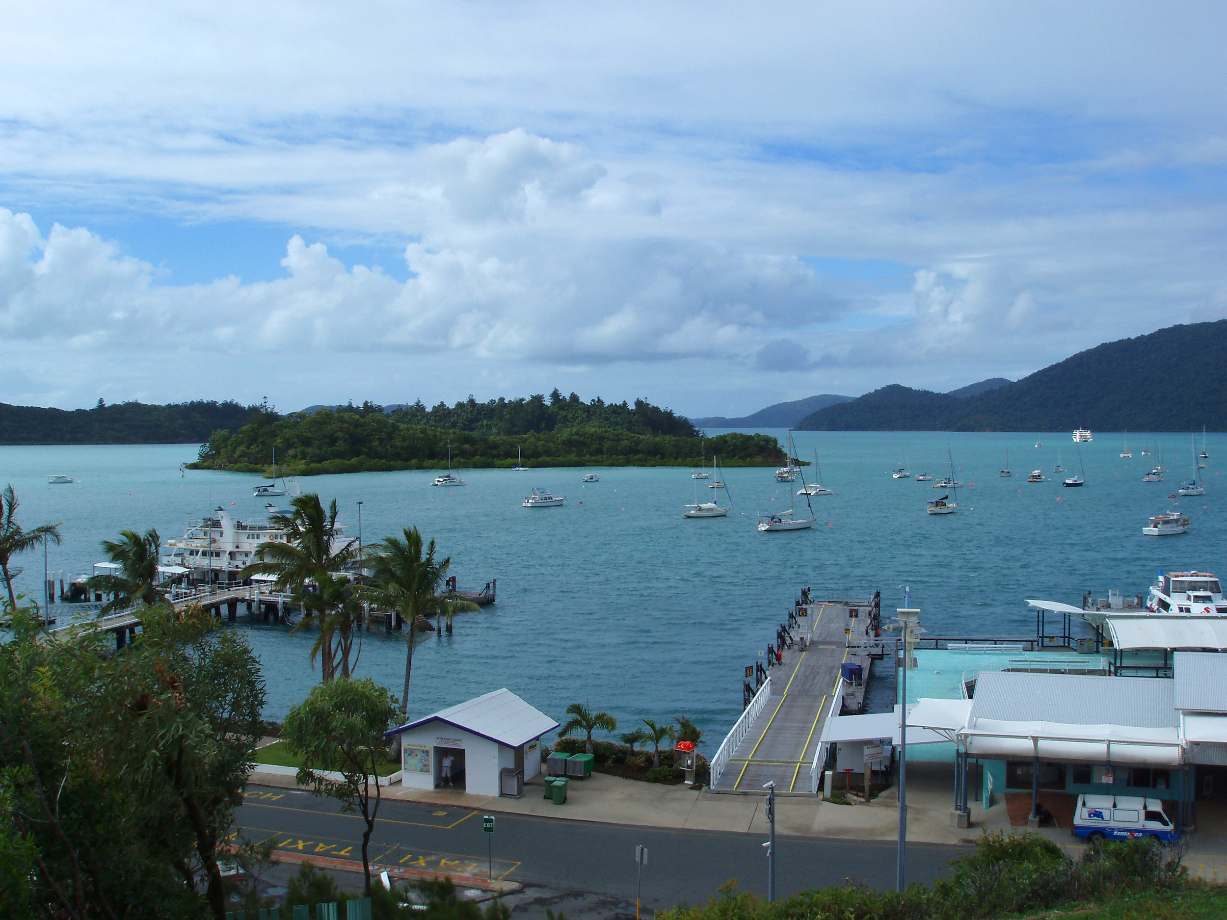 boats in sheltered moorings and the shute harbour ferry terminal, whitsunday, queensland,