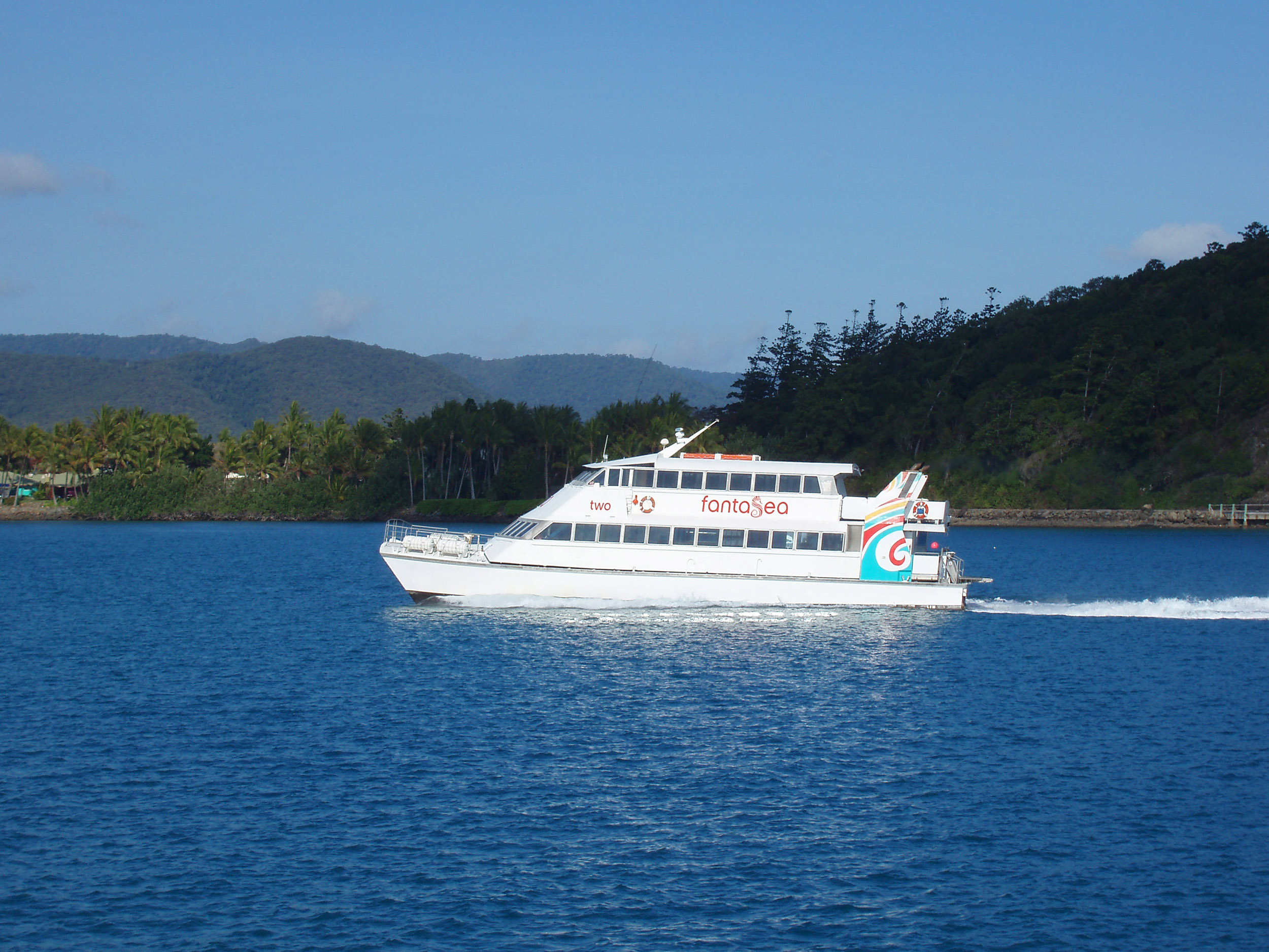 a small ferry off the coast off daydream island, whitsundays, queensland
