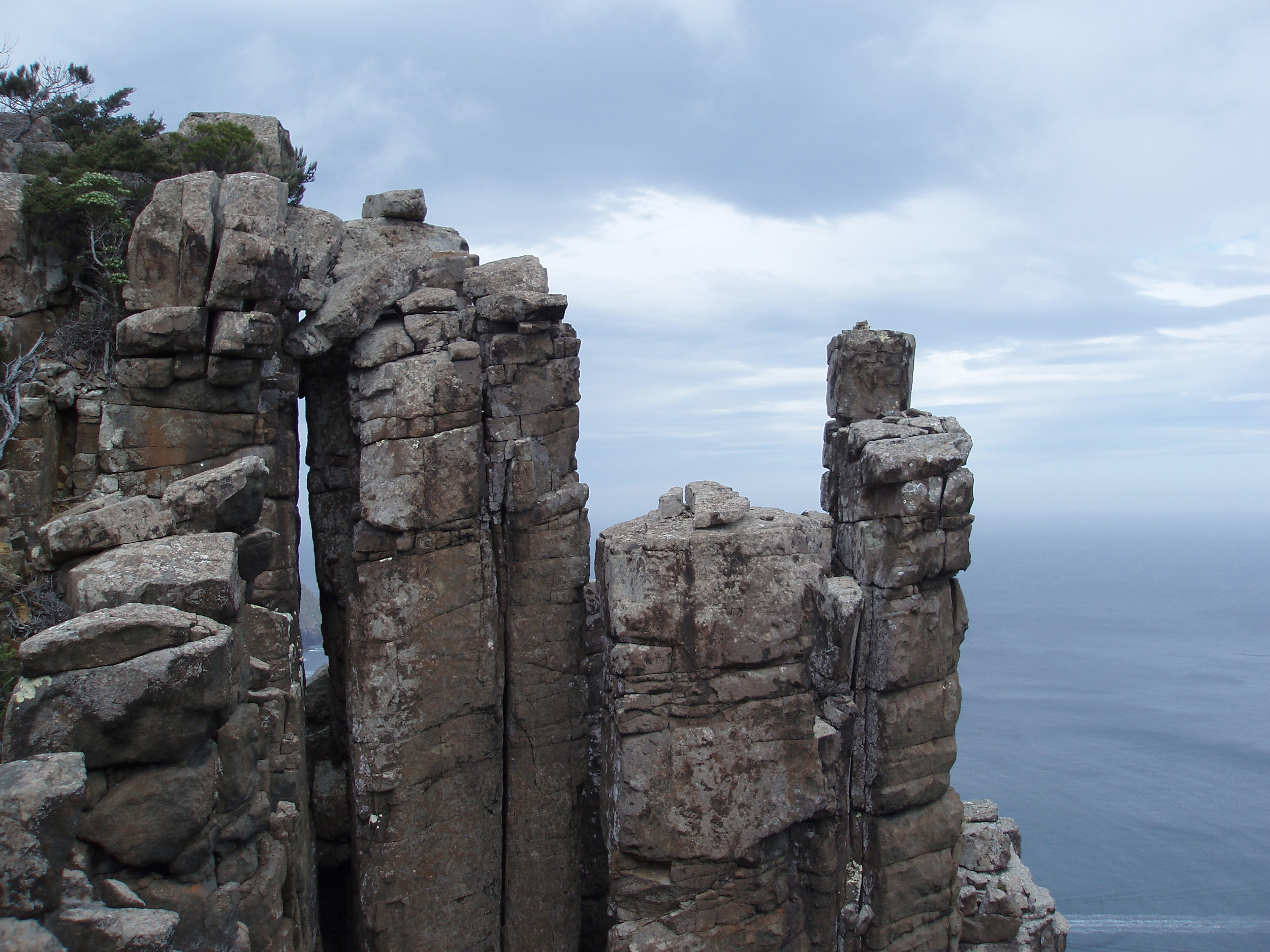 spectacular rocks formations with sheer vertical drops are a feature of the cliffs around cape pillar