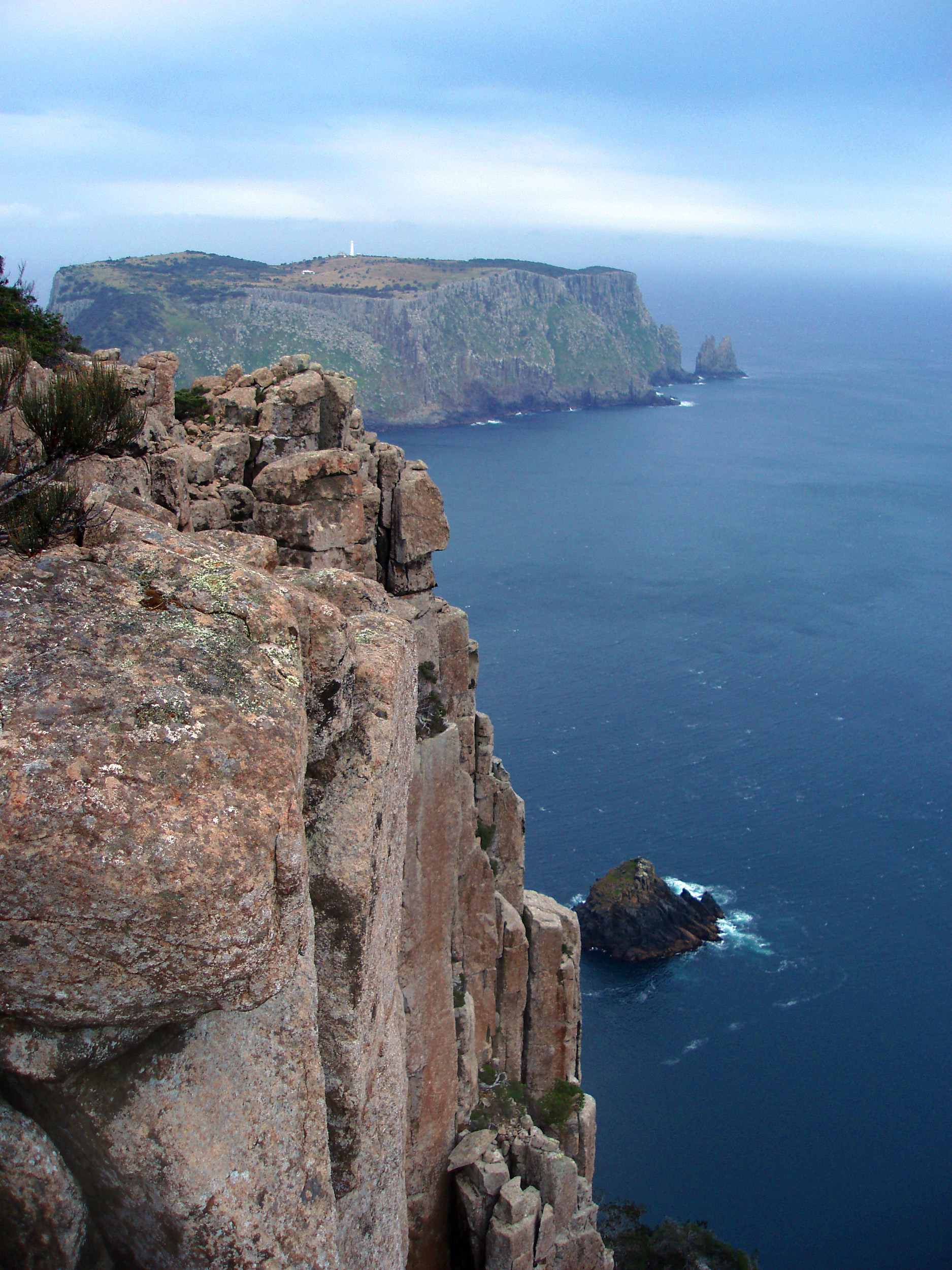 a view of tasman island and lighthouse viewed from the top of cliffs on cape pillar