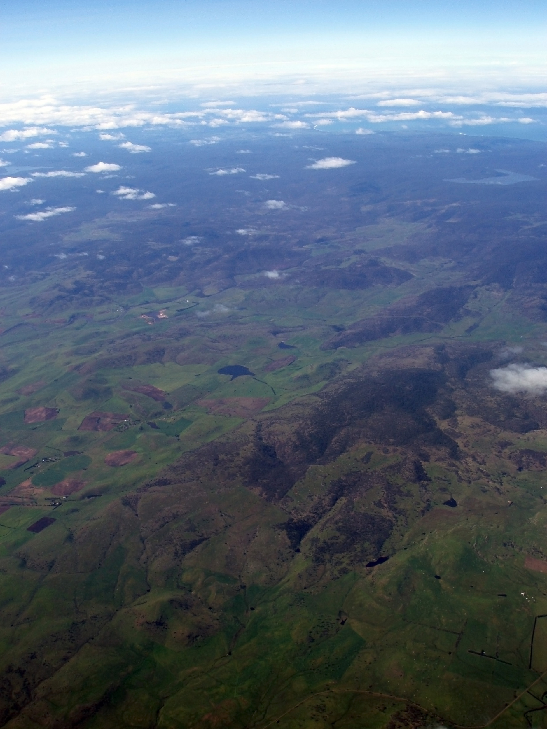 an aerial view of the tasmanian wilderness