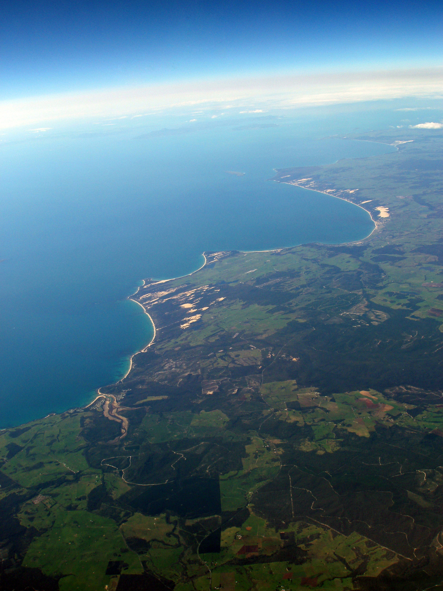 an aerial view of the tasmanian north coast fringing the bass straight