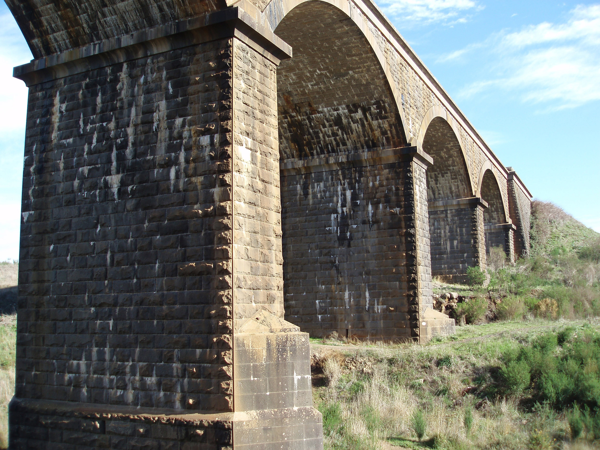 low angle view of a stone arch railway viaduct