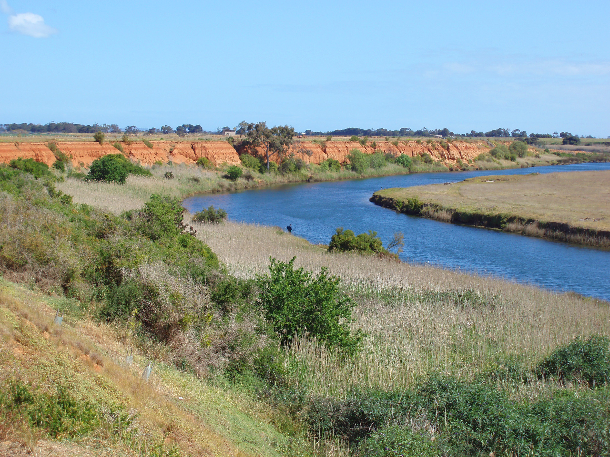 slow flowing waters and flood plain on the werribee river, victoria