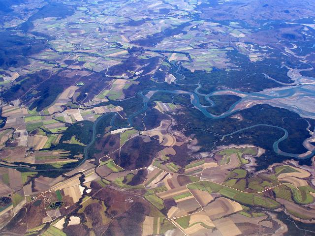 an aerial view of the murray river and surrounding farm land, north queensland